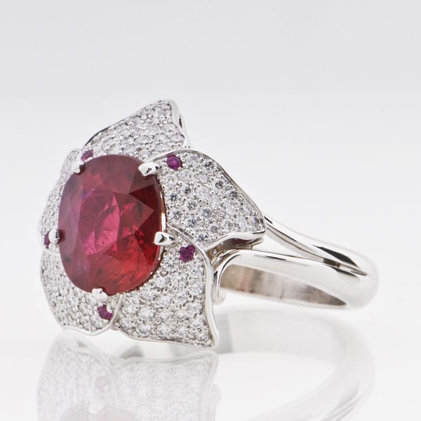Custom Ruby and diamond pave flower ring in Platinum  by Cronin Jewelers